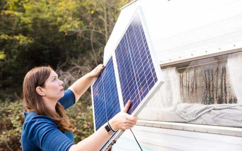 Lady carrying RV solar battery charger.