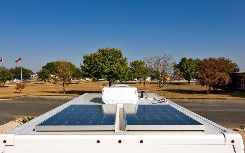 Image of top of an RV with 2 solar panels on it.